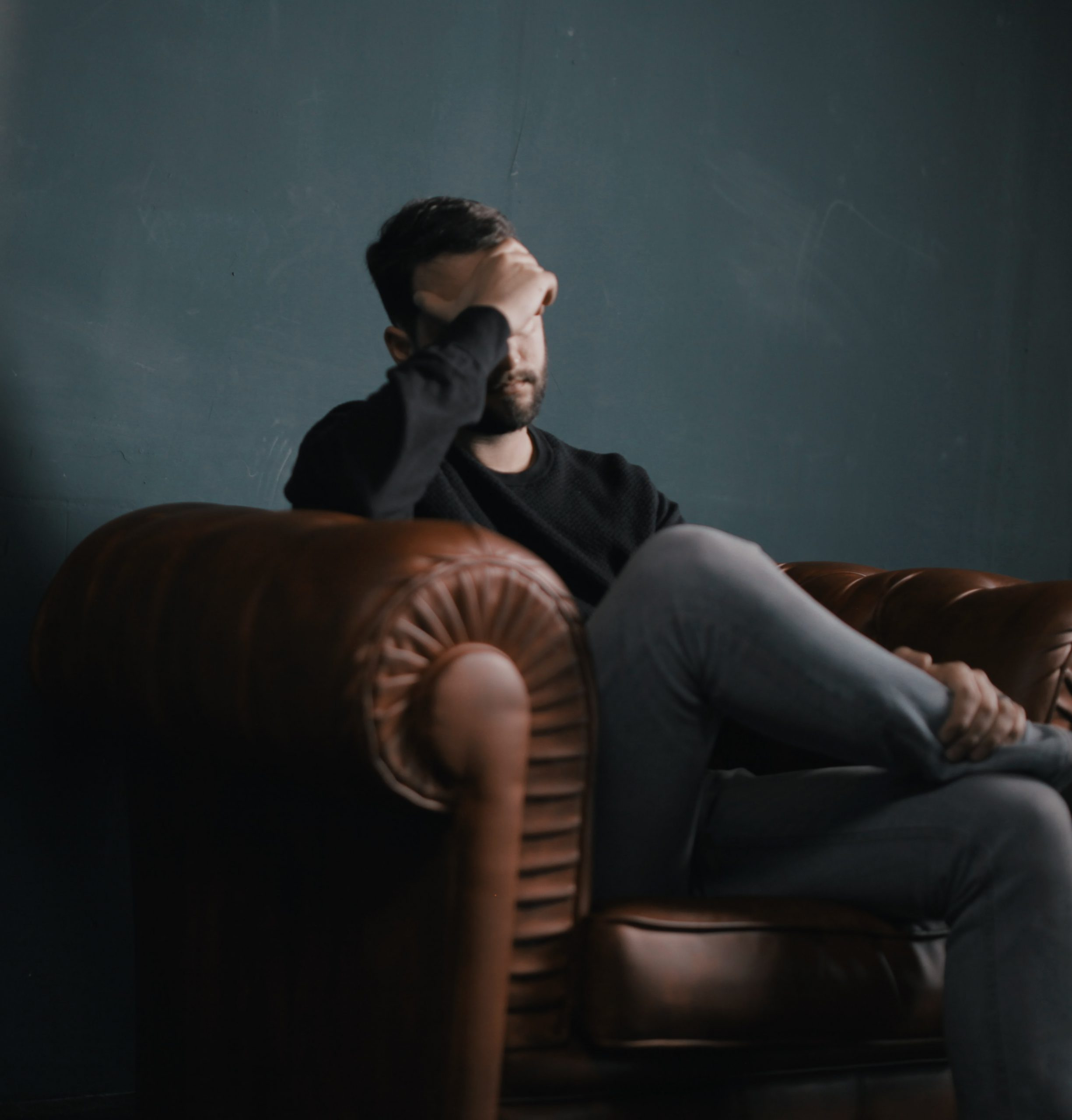 Depressed guy sitting in chair